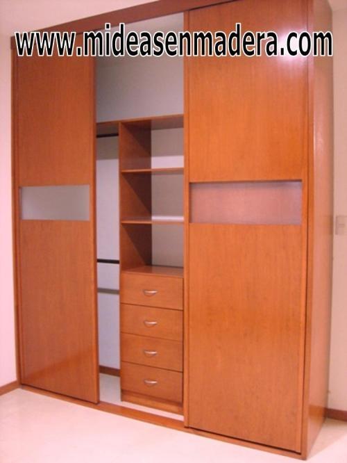Closets y vestidores de lujo closets de madera closets for Disenos de closet